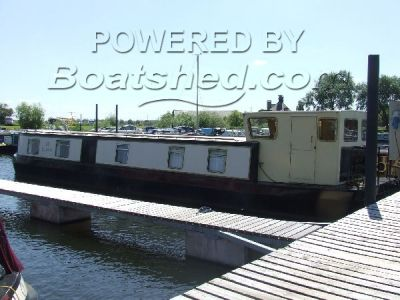 Wide Beam Houseboat