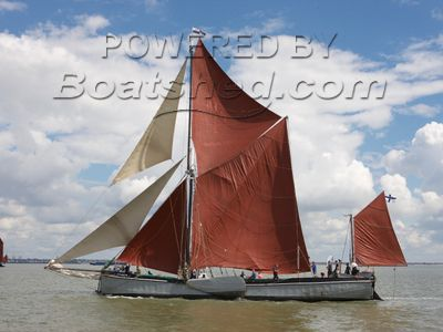 Thames Sailing Barge with London mooring