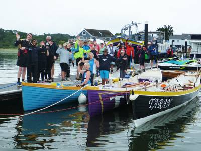 Traditional fixed seat rowing boats gather in Bembridge Harbour