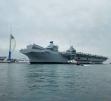 HMS Queen Elizabeth arrives in Portsmouth Harbour