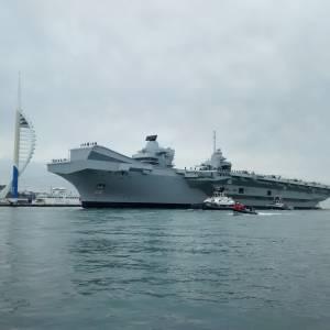 HMS Queen Elizabeth arrives in Portsmouth Harbour