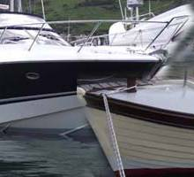 Two Boats – Yards Away but Years Apart